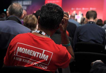 FILE PHOTO - A member of the audience wearing  'Momentum' political campaigning organisation T-shirt listens to speeches at the Labour Party Conference in Brighton