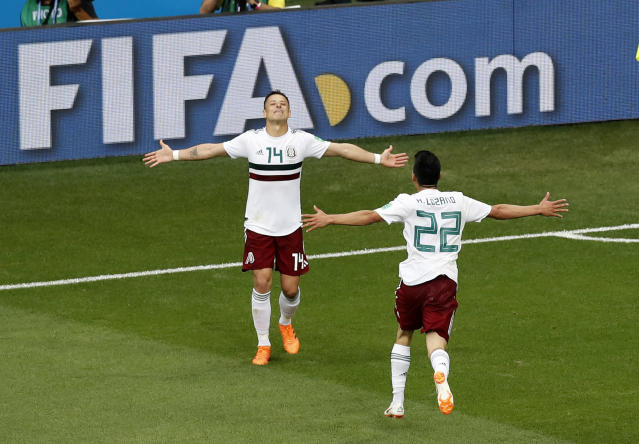 Mexico's Javier Hernandez, left, celebrates with teammate Hirving Lozano after scoring his teams second goal during the group F match between Mexico and South Korea at the 2018 soccer World Cup in the Rostov Arena in Rostov-on-Don, Russia, Saturday, June 23, 2018. (AP Photo/Efrem Lukatsky)