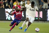 Los Angeles FC midfielder Jose Cifuentes, right, controls the ball next to Dallas FC forward Jader Obrian during the first half of an MLS soccer match Wednesday, June 23, 2021, in Los Angeles. (AP Photo/Marcio Jose Sanchez)