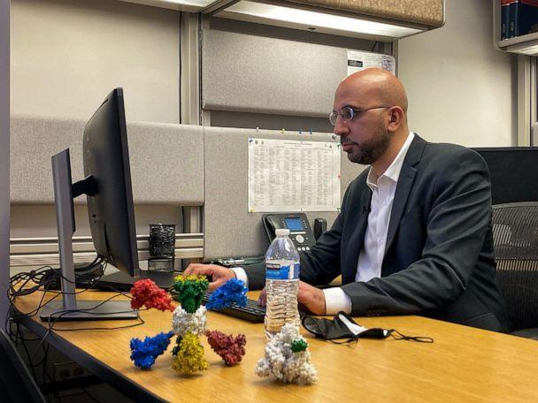 PHOTO: Dr. Kayvon Modjarrad sits at his desk adorned with a 3-D model of the vaccine he co-invented. Modjarrad is the director of the emerging infectious diseases branch of the Walter Reed Army Institute of Research (WRAIR). (Matt Seyler, ABC News)