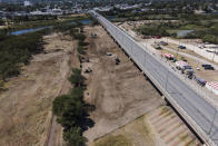 An area where migrants, many from Haiti, were encamped is seen after crews cleared the zone along the Del Rio International Bridge, Friday, Sept. 24, 2021, in Del Rio, Texas. (AP Photo/Julio Cortez)