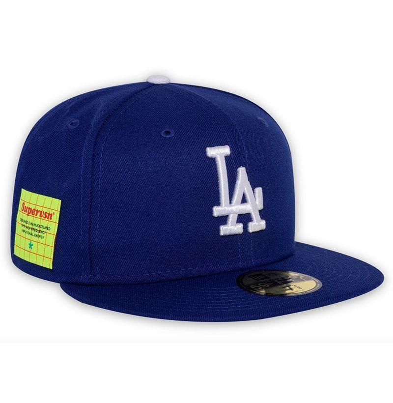 """<p><strong>Supervsn Studios</strong></p><p>supervsn.com</p><p><strong>$50.00</strong></p><p><a href=""""https://supervsn.com/collections/headwear/products/la-studio-hat-dodger-blue"""" rel=""""nofollow noopener"""" target=""""_blank"""" data-ylk=""""slk:Buy"""" class=""""link rapid-noclick-resp"""">Buy</a></p><p>A downtown L.A. scenester staple you don't need to be from the West Coast to appreciate? Hell yes. </p>"""