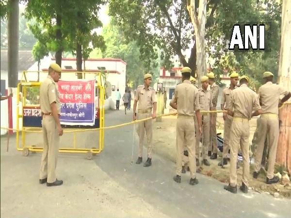 UP police personnel deployed outside MoS Ajay Mishra Teni's resident on Saturday (Photo/ANI)