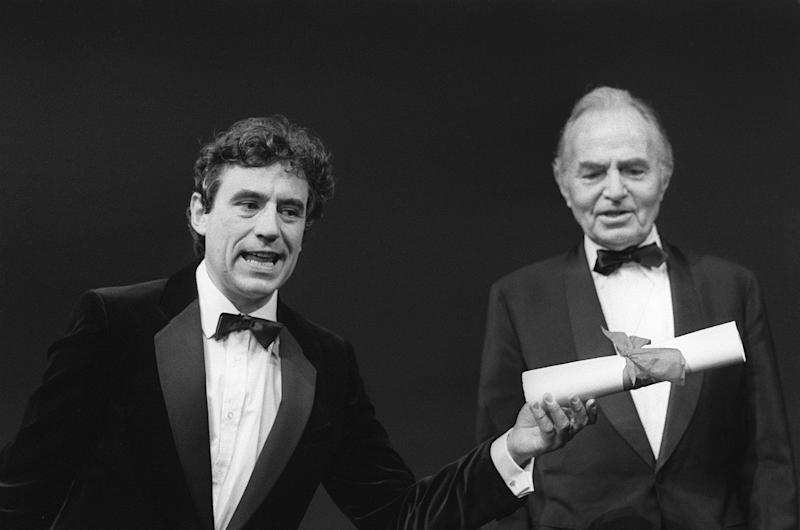 CANNES, FRANCE - MAY 19: Monty Python's Flying Circus comedy team are awarded the Special Jury Prize for their film 'The Meaning of Life' at the 1983 Cannes Film Festival in Cannes 19 May 1983. (In background British actor James Mason) (Photo credit should read GATTI-DUVAL/AFP/Getty Images)
