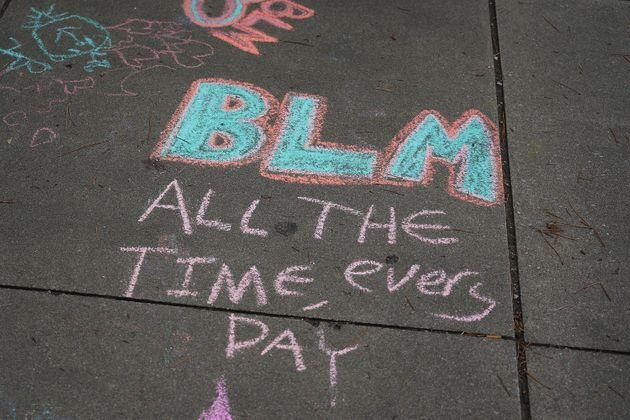 Chalked street art photographed at the Juneteenth celebration in the Greenwood District on June 19, 2020, in Tulsa, Oklahoma. (Photo: Michael B. Thomas via Getty Images)