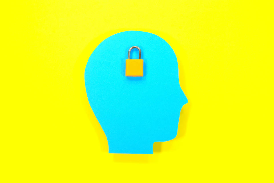 Concept of knowledge, data and protection. Paper human head with pad lock.