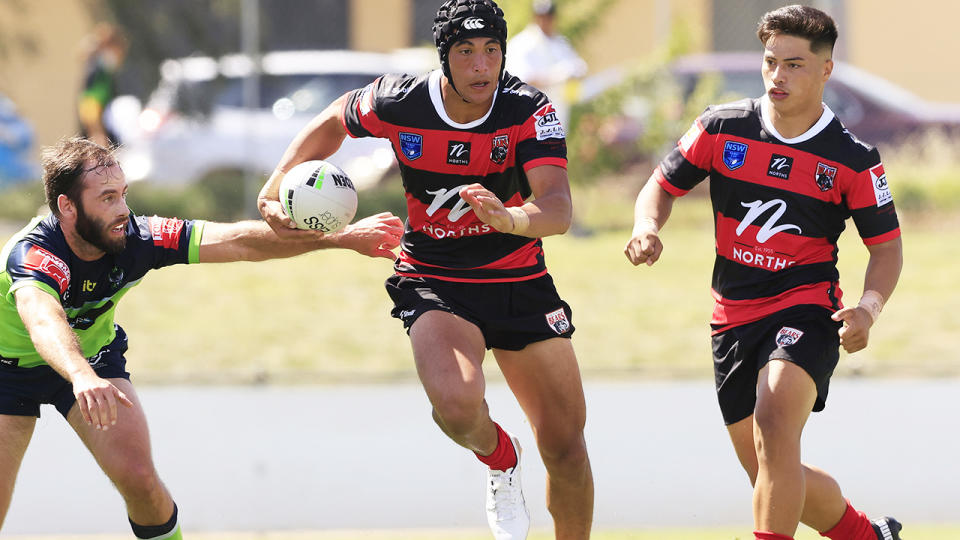 Joseph Suaalii, pictured here in action for North Sydney Bears against the Canberra Raiders.