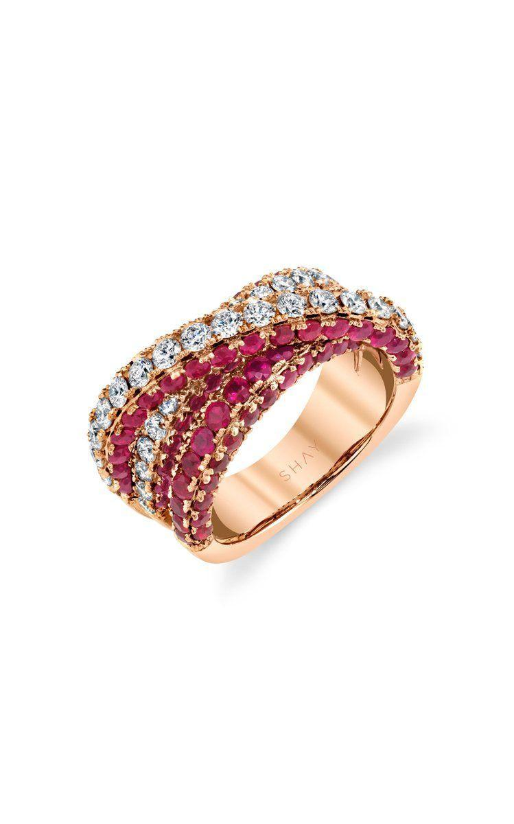 "<p>This double band is one-of-a-kind, and will layer beautifully with a wedding band, too.</p><p><em>""Three Sided Orbit"" ring in 18K rose gold ring with rubies and diamonds, $9,450, <a href=""https://shayjewelry.com/"" rel=""nofollow noopener"" target=""_blank"" data-ylk=""slk:shayjewelry.com"" class=""link rapid-noclick-resp"">shayjewelry.com</a>.</em></p><p><a class=""link rapid-noclick-resp"" href=""https://go.redirectingat.com?id=74968X1596630&url=https%3A%2F%2Fwww.modaoperandi.com%2Fwomen%2Fp%2Fshay%2F18k-rose-gold-diamond-ruby-three-sided-orbit-ring%2F481391&sref=https%3A%2F%2Fwww.harpersbazaar.com%2Fwedding%2Fbridal-fashion%2Fg24856146%2Fruby-engagement-rings%2F"" rel=""nofollow noopener"" target=""_blank"" data-ylk=""slk:SHOP"">SHOP</a></p>"