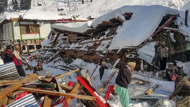 PHOTO: Local residents remove debris of a collapsed house following heavy snowfall that triggered an avalanche in Neelum Valley in the Pakistan-controlled portion of Kashmir on Jan. 14, 2020. (STR/AFP via Getty Images)