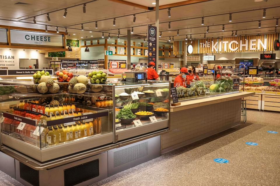 The cheese, fruit and vegetable sections seen in a new Coles supermarket concept.