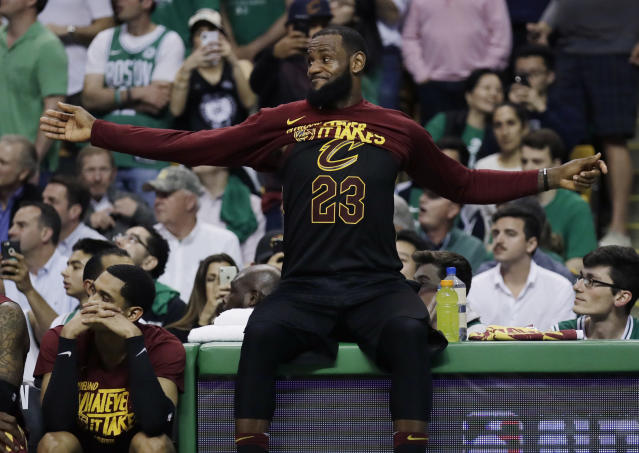 Cleveland Cavaliers forward LeBron James (23) puts his jersey on as he watches from the bench area near the end of Game 5 of the team's NBA basketball Eastern Conference finals against the Boston Celtics, Wednesday, May 23, 2018, in Boston. The Celtics won 96-83. (AP Photo/Charles Krupa)