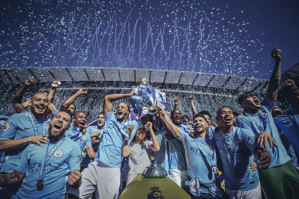 Manchester City lifts the 2017-18 Premier League trophy. (Getty)