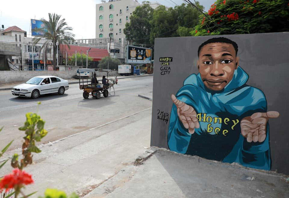 A mural by Khaby Lame is seen on the wall of a building in Gaza City on July 26, 2021Khabane Lame, 21-year-old Senegalese origin and resident in Italy, has become famous with his short comic skits and a few days ago he became the second most influencer TikTok account. (Photo by Majdi Fathi/NurPhoto via Getty Images)