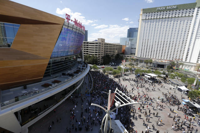 Fans arrive for Game 2 of the NHL hockey Stanley Cup Finals between the Vegas Golden Knights and the Washington Capitals on Wednesday, May 30, 2018, in Las Vegas. (AP Photo/Ross D. Franklin)
