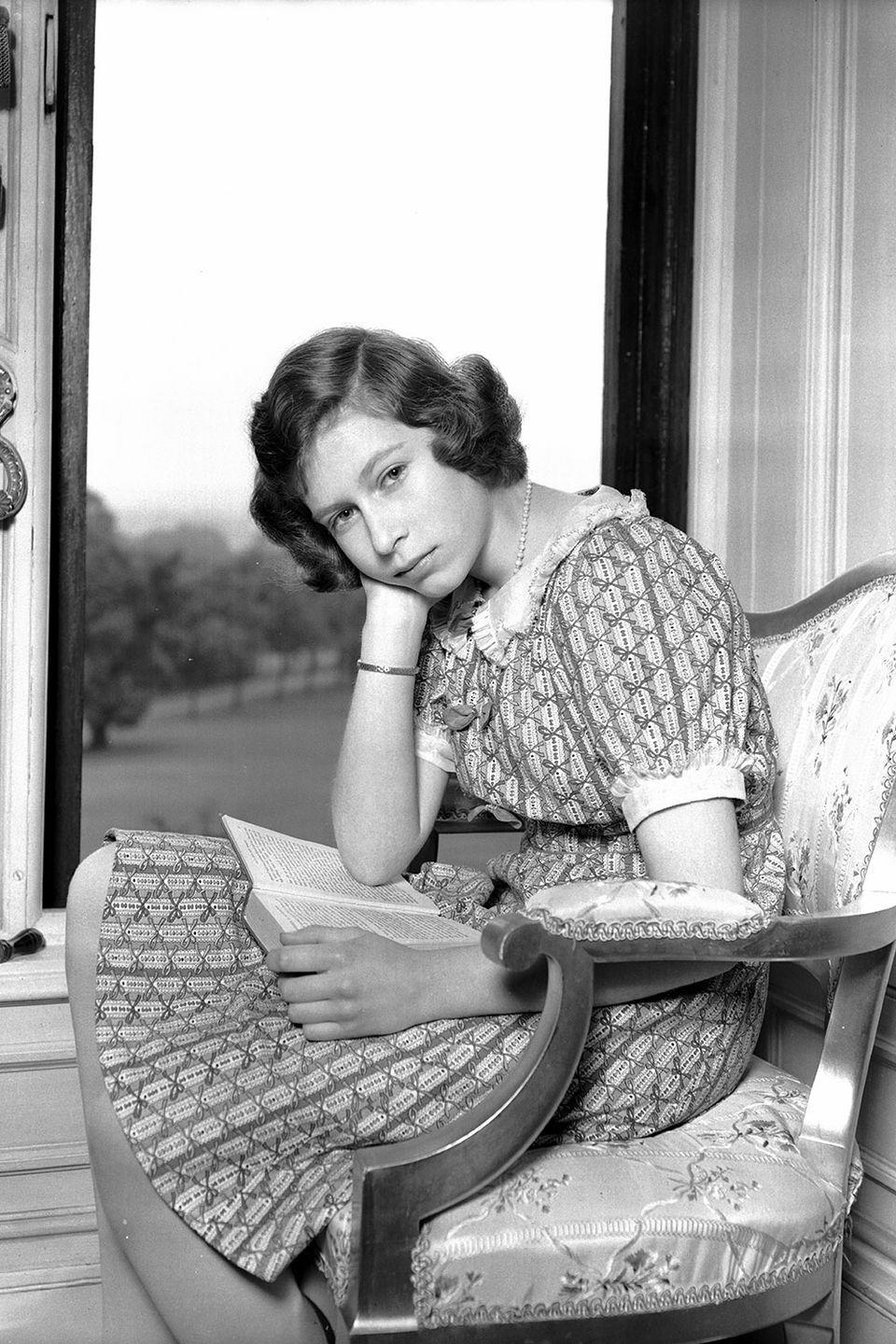 <p>Princess Elizabeth took a quick break from reading for a quick photograph on a porch at Windsor Castle.</p>