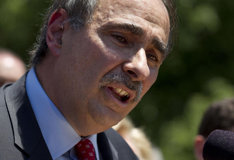 """In this photo taken May 31, 2012, Obama adviser David Axelrod speaks to a crowd in front of the Statehouse, in Boston, where he criticized the gubernatorial record of Republican presidential challenger Mitt Romney. After the first presidential debate between President Barack Obama and Romney, Axelrod has called Romney """"devoid of honesty,"""" a deliverer of """"fraudulent"""" lines, a man who was """"hiding the truth and the facts."""" The Obama campaign released an ad all about truth and trust, and how Romney falls short. (AP Photo/Steven Senne, File)"""