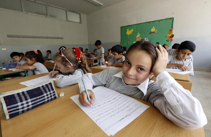 Young Syrian refugees attend class at a public school in the Lebanese village of Zahle on May 30, 2014 (AFP Photo/Anwar Amro)