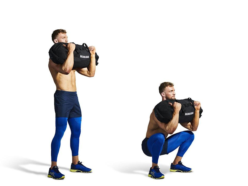 <ol><li>With the bag standing tall, squat down and wrap your arms around it, 'hug' the bag as tightly as possible before standing upright. The bag should be covering your entire torso. </li><li>Squat down until the crease of your hip passes your knee before returning to standing, maintain an upright posture and tightly squeeze on the bag throughout.</li></ol>