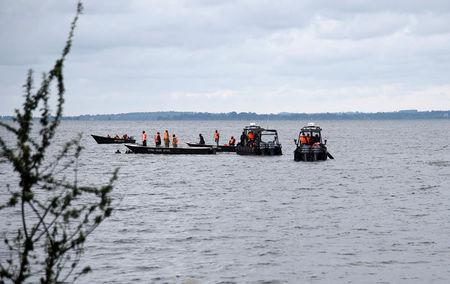 Rescue and recovery missions search for the bodies of dead passengers after a cruise boat capsized in Lake Victoria off Mukono district, Uganda November 25, 2018. REUTERS/Newton Nambwaya