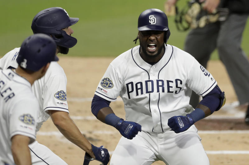 CORRECTS INNING TO SECOND INNING INSTEAD OF 22ND INNING - San Diego Padres' Franmil Reyes, right, reacts with teammates after hitting a two-run home run during the second inning of a baseball game against the Seattle Mariners, Tuesday, April 23, 2019, in San Diego. (AP Photo/Gregory Bull)