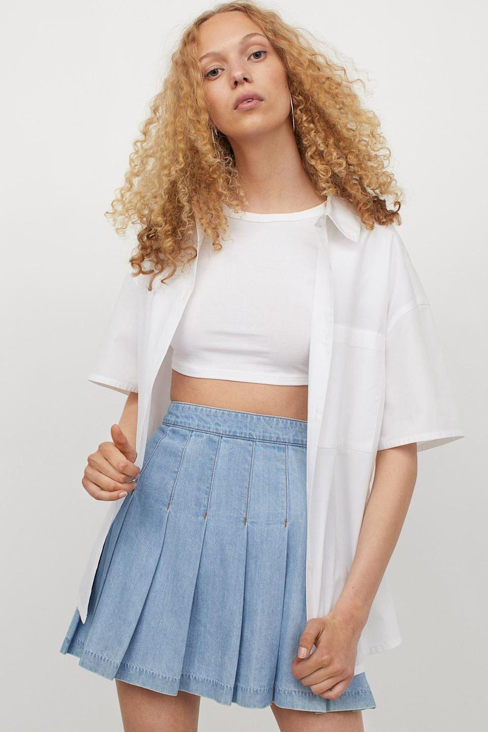<p>Style this <span>Pleated Denim Skirt</span> ($30) with your favorite crop top for a sporty and intentional look.</p>