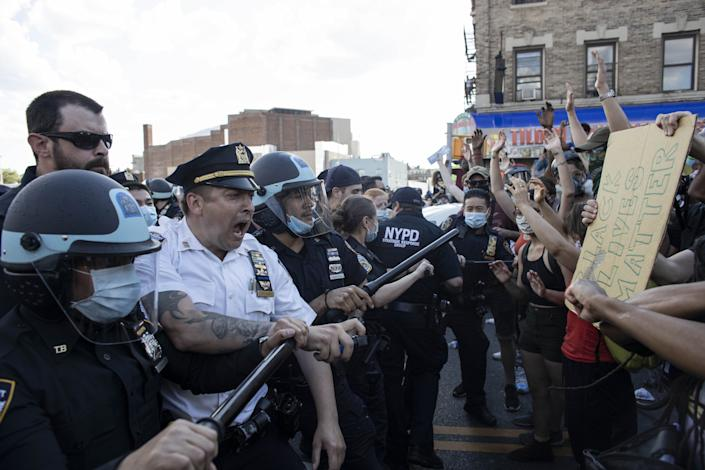 Protesters face off with police officers