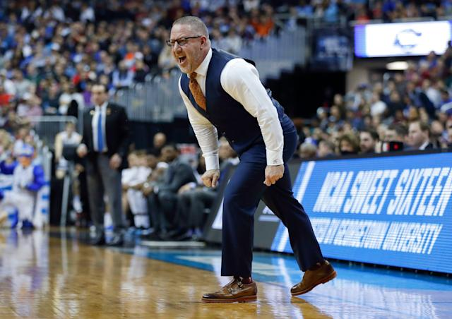 Virginia Tech coach Buzz Williams yells across the court to his players during the first half of the team's NCAA men's college basketball tournament East Region semifinal against Duke in Washington, Friday, March 29, 2019. (AP Photo/Patrick Semansky)