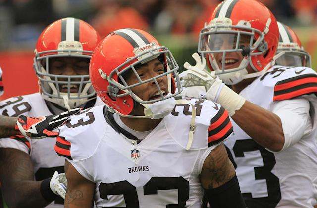 Cleveland Browns cornerback Joe Haden (23) celebrates after he returned an interception for a touchdown in the first half of an NFL football game against the Cincinnati Bengals, Sunday, Nov. 17, 2013, in Cincinnati. (AP Photo/Tom Uhlman)