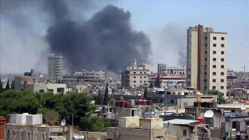 A UNSMIS image shows smoke rising following shelling from the central flashpoint city of Homs on June 11