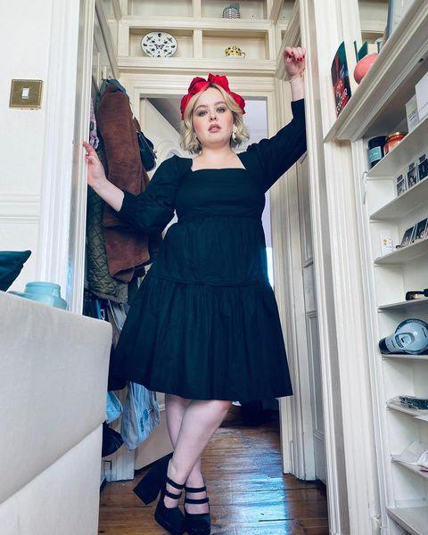 """<p>Coughlan wore a black midi dress by Three Graces with heels by Nodaleto.</p><p><a class=""""link rapid-noclick-resp"""" href=""""https://go.redirectingat.com?id=127X1599956&url=https%3A%2F%2Fwww.matchesfashion.com%2Fwomens%2Fdesigners%2Fnodaleto&sref=https%3A%2F%2Fwww.elle.com%2Fuk%2Ffashion%2Fcelebrity-style%2Fg35467465%2Fnicola-coughlan-style%2F"""" rel=""""nofollow noopener"""" target=""""_blank"""" data-ylk=""""slk:SHOP NODALETO NOW"""">SHOP NODALETO NOW</a></p><p><a href=""""https://www.instagram.com/p/CJYrpbxAydv/"""" rel=""""nofollow noopener"""" target=""""_blank"""" data-ylk=""""slk:See the original post on Instagram"""" class=""""link rapid-noclick-resp"""">See the original post on Instagram</a></p>"""