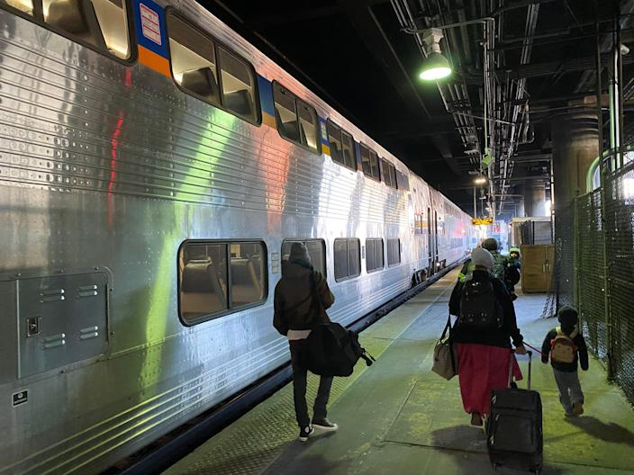 <p>A train waits on the platform in Washington DC. A little way up the platform, the Amtrak Capitol Limited waits to begin a 17-hour journey to Chicago. </p> (Richard Hall/The Indepedent)