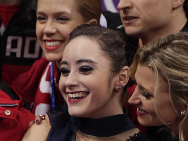 <p>Osmond, surrounded by her teammates as she waits for her score following her performance in the ladies single figure skating short program in the Gangneung Ice Arena at the 2018 Winter Olympics in Gangneung, South Korea, Sunday, Feb. 11, 2018 (AP) </p>