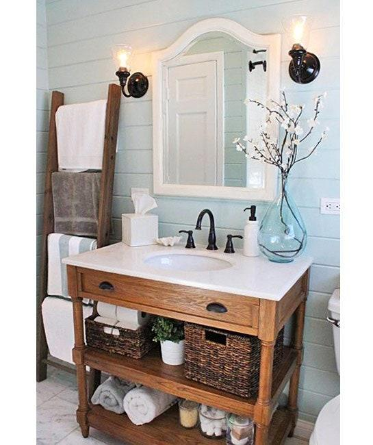 """<h1 class=""""title"""">A vintage vanity with an undermount basin.</h1><cite class=""""credit""""><p>A vintage vanity with an undermount basin.</p> <p>Photo courtesy of Making Home Base</p></cite>"""