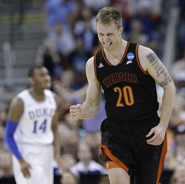 Mercer forward Jakob Gollon (20) celebrates a goal against Duke during the first half of an NCAA college basketball second-round game, Friday, March 21, 2014, in Raleigh, N.C. (AP Photo/Gerry Broome)