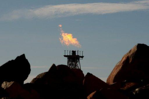 This file photo shows a gas flare (C) at the Woodside operated North West Shelf Venture in the north of Western Australia, in 2008. Australia has enough gas reserves to maintain current production for almost 200 years, according to a report released on Monday, supporting the nation's push to become a global exporter to rival Qatar