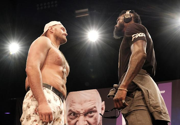 WBC heavyweight champion Tyson Fury and Deontay Wilder III face off in street clothes