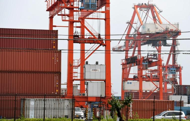 Japan trade surplus sinks in October as energy imports surge