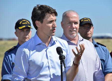 Canada's Prime Minister Justin Trudeau addresses the media following wildfire tour in Williams Lake