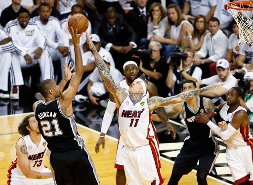 MIAMI, FL - JUNE 18: Tim Duncan #21 of the San Antonio Spurs shoots over Chris Andersen #11 of the Miami Heat in the first half during Game Six of the 2013 NBA Finals at AmericanAirlines Arena on June 18, 2013 in Miami, Florida. (Photo by Kevin C. Cox/Getty Images)