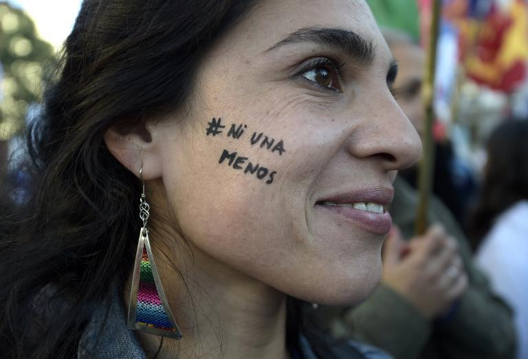 "A demonstrator during the rally ""Ni una menos"" (Not One Less) against femicide in Buenos Aires, on June 3, 2015"