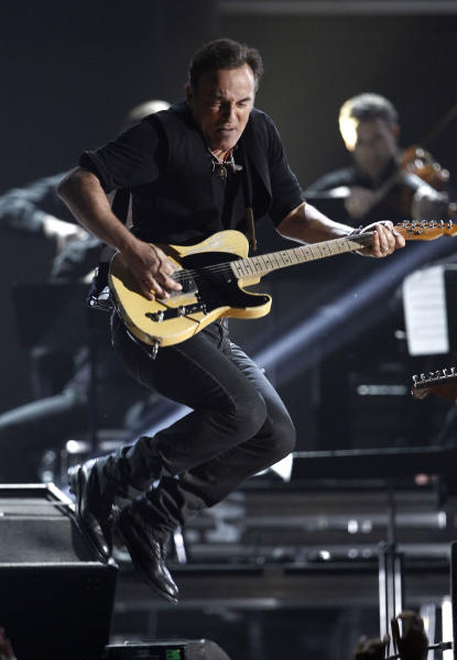 FILE - In this Feb. 12, 2012 file photo, Bruce Springsteen performs during the 54th annual Grammy Awards in Los Angeles. Springsteen will perform at the annual South by Southwest Conference and Festival in Austin, Texas. (AP Photo/Matt Sayles, file)