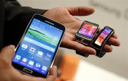 New Samsung Galaxy S5 smarphone, Gear 2 smartwatch and Gear Fit fitness band are displayed at the Mobile World Congress in Barcelona