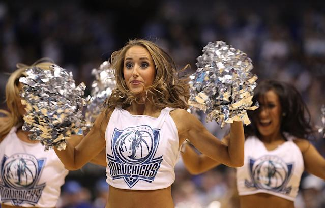 DALLAS, TX - APRIL 19: A Dallas Mavericks dancer performs during Game Two of the Western Conference Quarterfinals during the 2011 NBA Playoffs on April 19, 2011 at American Airlines Center in Dallas, Texas. NOTE TO USER: User expressly acknowledges and agrees that, by downloading and or using this photograph, User is consenting to the terms and conditions of the Getty Images License Agreement. (Photo by Ronald Martinez/Getty Images)