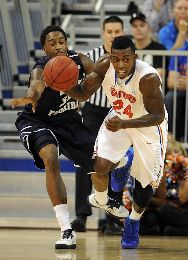 Florida forward Casey Prather (24) drives down court after stealing the ball from North Florida forward Chris Davenport (35) in the first half of an NCAA college basketball game, Friday, Nov. 8, 2013 in Gainesville, Fla. Prather scored a career-high 28 points in Florida's 77-69 win. (AP Photo/Phil Sandlin)