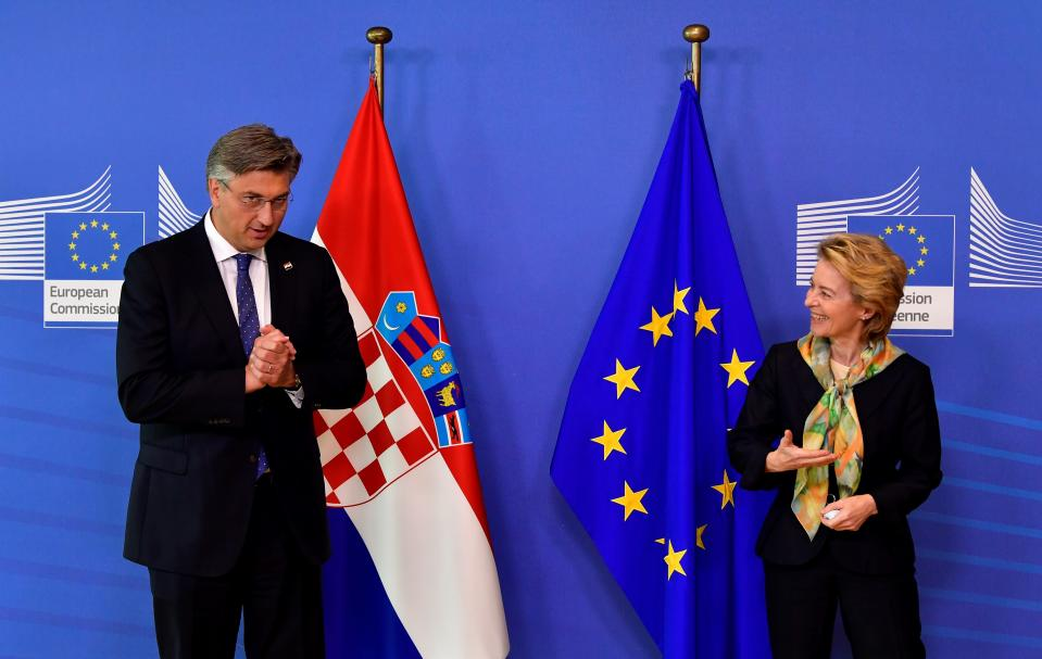 European Commission President Ursula von der Leyen, right, welcomes Croatian Prime Minister Andrej Plenkovic prior to a meeting at EU headquarters in Brussels, Thursday, July 16, 2020. (John Thys, Pool Photo via AP)