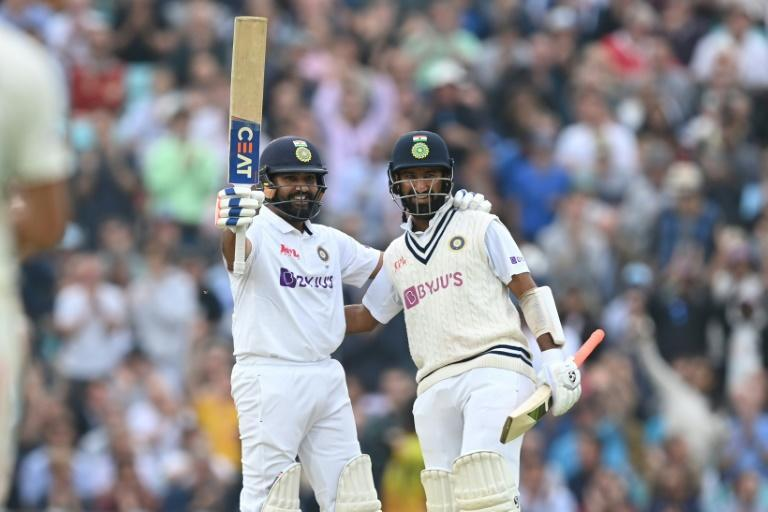 India's Rohit Sharma (L) celebrates scoring his first Test hundred away from home (AFP/DANIEL LEAL-OLIVAS)