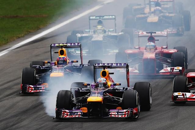 MONZA, ITALY - SEPTEMBER 08: Sebastian Vettel of Germany and Infiniti Red Bull Racing locks up under braking going into the first corner at the start of the the Italian Formula One Grand Prix at Autodromo di Monza on September 8, 2013 in Monza, Italy. (Photo by Paul Gilham/Getty Images)