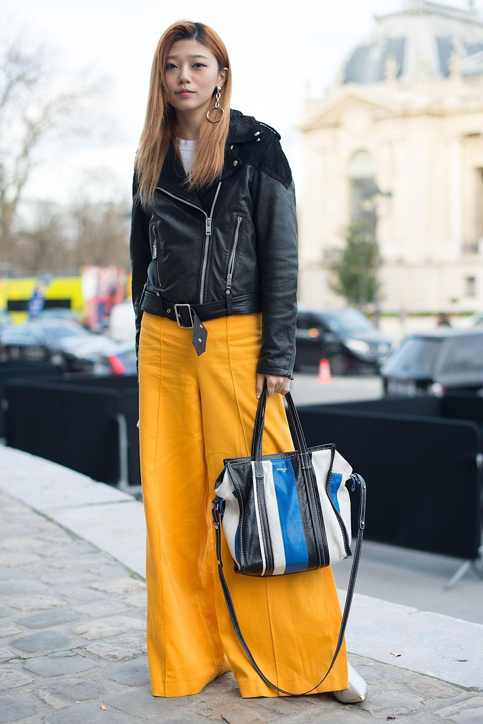 <p>The addition of a moto jacket gives these wide-leg pants more contemporary vibes. </p>