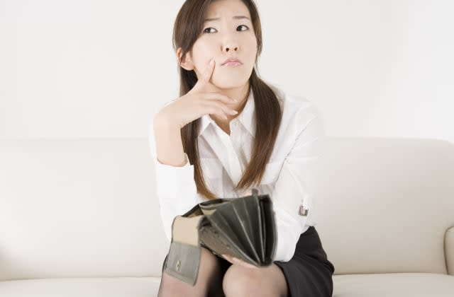Young woman holding empty wallet