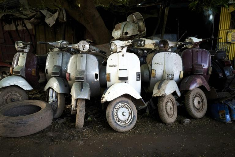 Ageing beauties: Several hundred classic Vespas, most of them made in the 1970s, still cruise the streets of Bamako